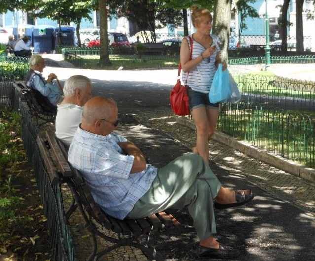 Walking_Past_Old_Men_Sleeping_(5960854556)